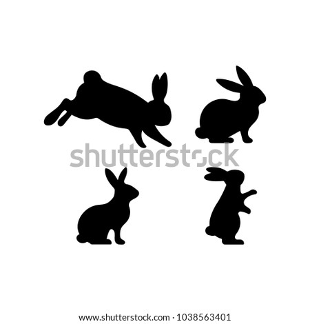 A set of Easter rabbits silhouette in different shapes and actions isolated on a white background. Cartoon vector element.