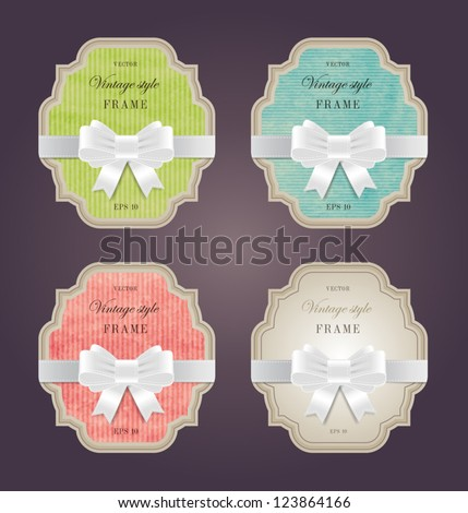 A set of elegant hand made colored paper textured retro labels with silky ribbon bow knots