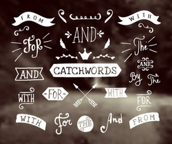 A set of hand drawn catchwords and design elements on a blurred vintage background. Hand drawn words