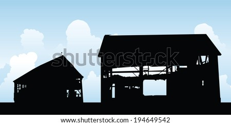 A silhouette of an old, abandoned barn.
