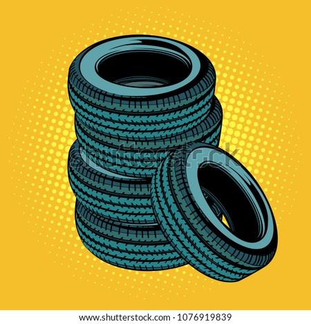 a stack of car tires pop art