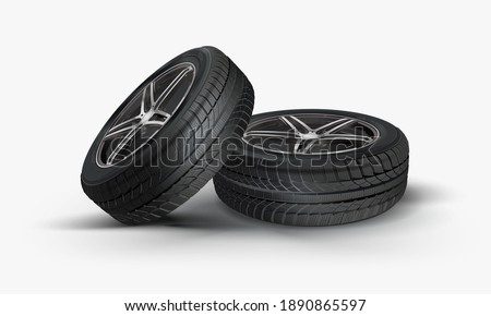 A stack of summer and winter tires. Tires service. Car tire set. Replacement tires for the season. Tire and wheel of automobile wheel on a white background. Service stack.