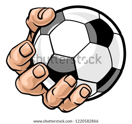a strong hand holding a soccer