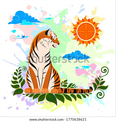 a tiger is sitting on the grass