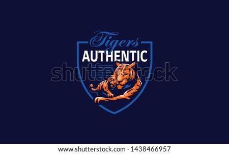 A tigress with a tiger cub lies. Vector illustration.
