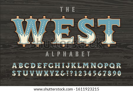 A western, old west frontier, cowboy, or circus Americana alphabet; this font has ornate outlines with copper effects and inner two-toned detailing. Good for circus carnival graphics, signage, etc.