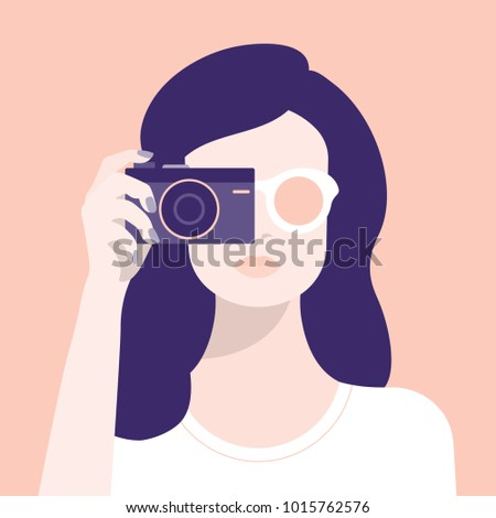 a woman and a camera