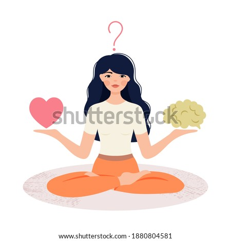 A woman in the Lotus position holds a heart and a brain in her hands. The concept of combining and balancing love and reason. The girl makes a choice of shower or brain. Foto stock ©
