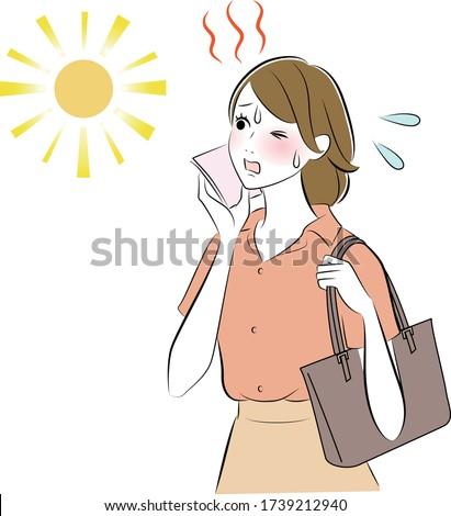 A woman wiping sweat tiring with sunburn. Photo stock ©