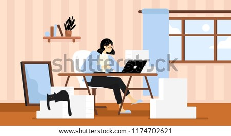 a woman working at her desk at