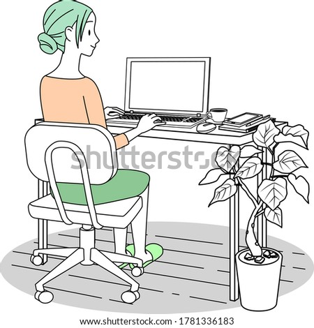 A woman working at home with a personal computer