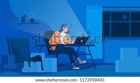 a woman working until night at