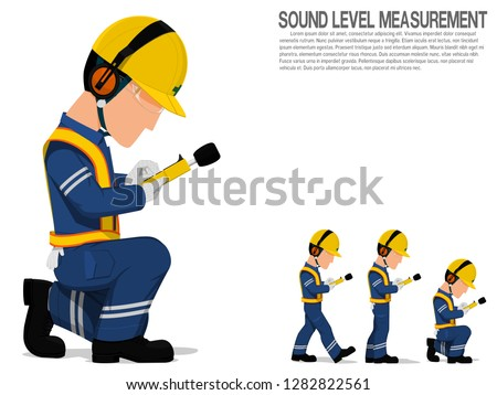 A worker with earmuff is operating sound level measuring equipment.