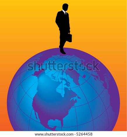 A young businessman stands on top of the world