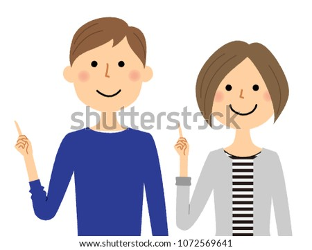 A young couple pointing a finger