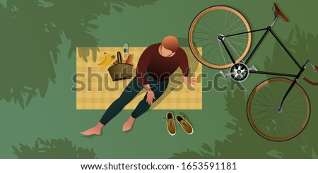 a young cyclist resting on a