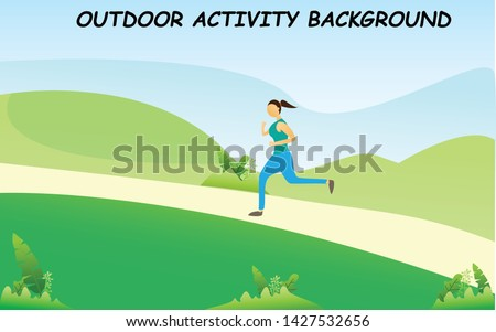 a young girl jogging on jogging track and green area in background