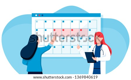 A young woman marks the date of menstruation in the online calendar. An application to track your menstrual cycle and birth control. Online doctor gynecology