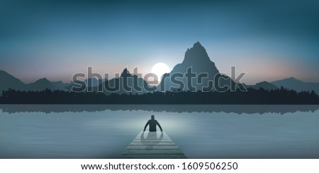 a zen man  seated on a pontoon