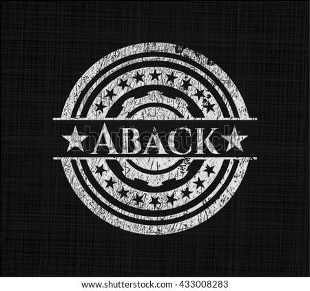 Aback chalk emblem written on a blackboard
