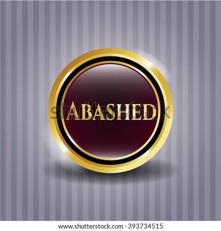 Abashed golden emblem or badge