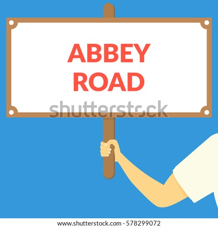 abbey road hand holding wooden