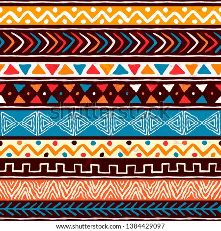 Abstract african art style seamless pattern. Hand drawn tribal decoration background with boho doodle shapes and ethnic symbols.