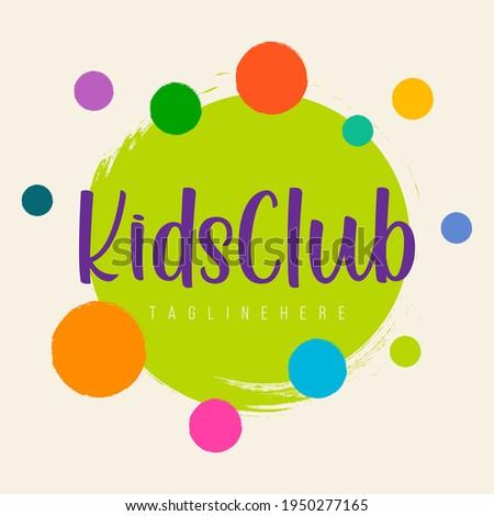 Abstract amusing bright circles kids world logo,childhood planet sign,kids club icon,playground symbol.Design templates kid shop,toy store,kindergarten,kids city.Vector illustration hand drawn.