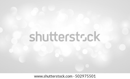 Abstract background with bokeh effect. Blurred defocused lights in white colors. White bokeh lights on gray background.