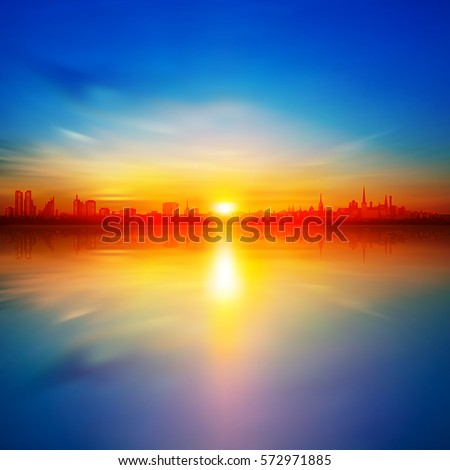 abstract background with gold spring sunrise and silhouette of city