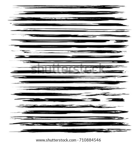 Abstract black long thin textured brush strokes isolated on a white background