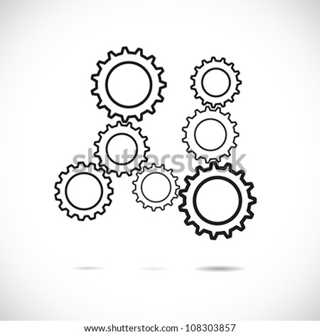 Abstract cogwheels or gears in black and white showing controlled rotating motion implying harmonious & balanced working system. The graphic illustrates teamwork, balance, synchronization, etc