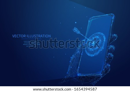Abstract digital marketing concept. Isolated blue polygonal target on smartphone screen in a hand. Low poly wireframe digital vector illustration. Polygons, particles, lines and connected dots.