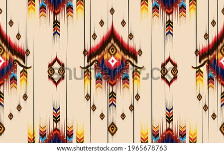 Abstract ethnic geometric pattern design for background or wallpaper,Ikat geometric folklore ornament. Tribal ethnic vector texture. Seamless striped pattern in Aztec style. Figure tribal embroidery.