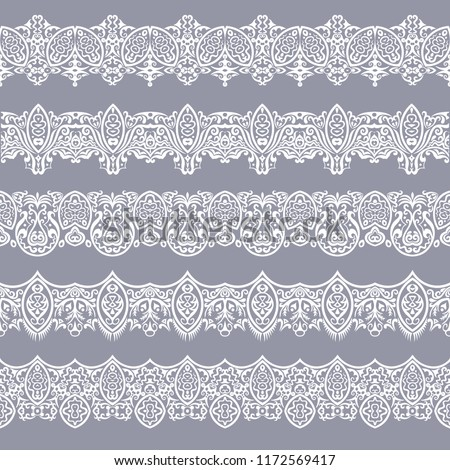 Abstract ethnic nature seamless line art stripes set. Ornamental lace vector borders #1172569417