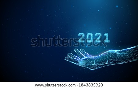 Abstract giving hand with number 2021. Low poly style design. Merry Christmas card. Modern 3d graphic geometric background. Wireframe light connection structure. Isolated vector illustration