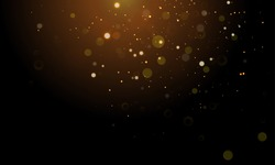 Abstract glitter light on black background with gold bokeh