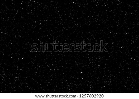 Abstract grainy texture isolated on black background. Top view. Dust, sand blow Silhouette of spread on the flat surface or table.