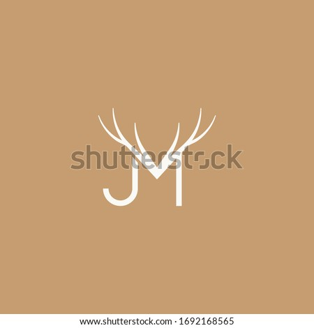 Abstract graphic vector illustration of two letters J and M with a pattern in the form of deer horns Foto stock ©