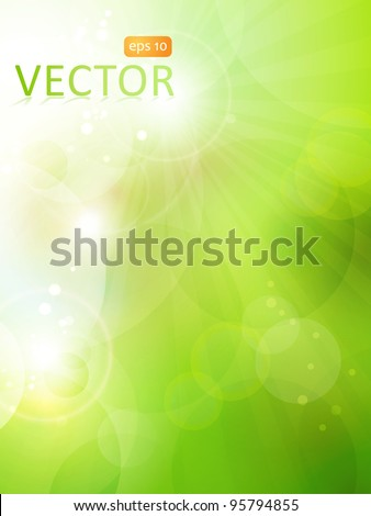 Abstract green blurry background with overlying semitransparent circles, light effects and sun burst. Great spring or green environmental background. Space for your text. EPS10