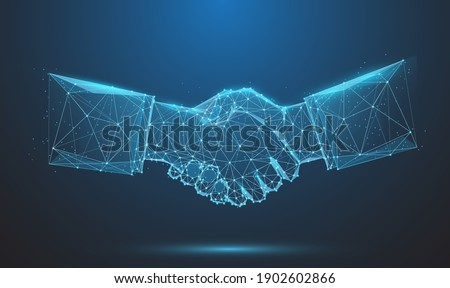 Abstract image of Business handshake in glowing blue. Low polygon, particle, and triangle style design.Wireframe light connection structure or points, lines, and shapes in the form of planets, stars Foto stock ©