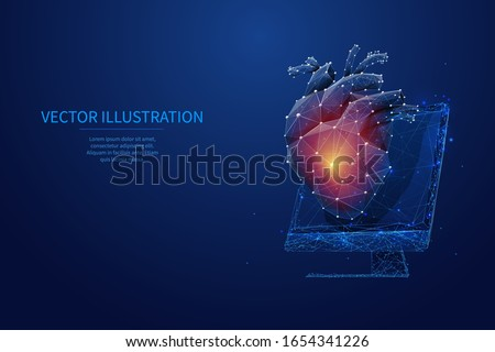 Abstract isolated polygonal human heart on pc monitor on dark blue background. Technology innovation in medicine or science concept. Low poly wireframe human organ with polygons and connected dots.