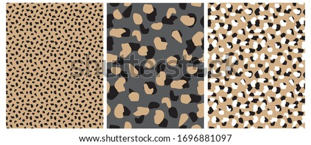 Abstract Leopard Skin Seamless Vector Patterns. White, Brown and Black Irregular Brush Spots on a Gray and Gold Backgrounds.  Abstract Wild Animal Skin Print. Simple Irregular Geometric Design. stock photo