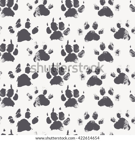 Abstract seamless pattern - black ink prints with messy dog paws. Creative monochrome backdrop with regular animal footprints