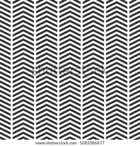 Abstract seamless pattern of arrows. Rhythmic structure of herringbone. Monochrome stylish texture with chevron. Vector geometric background.