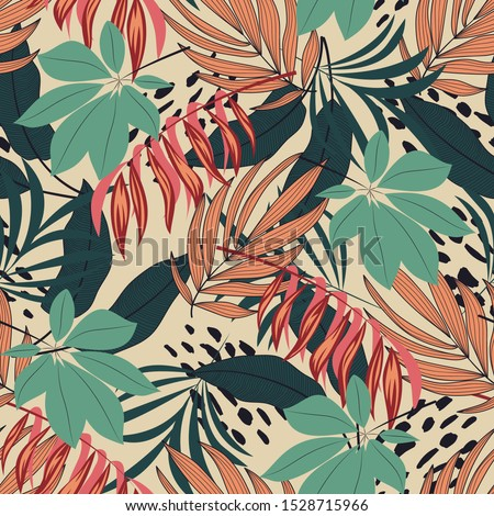 Abstract seamless tropical pattern with bright colorful leaves and plants on pastel background. Seamless exotic pattern with tropical plants. Exotic wallpaper.  Trendy summer Hawaii print.