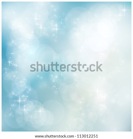 Abstract soft blurry background with bokeh lights and stars in soft blues. The festive feeling makes it a great backdrop for many winter, Christmas designs. Copyspace.