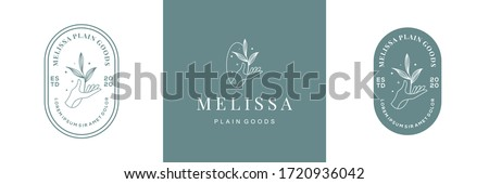 abstract vector logo design with hand and leaves. symbol for cosmetics, jewellery, beauty products badge on feminine style. suitable for floral and botanical business Photo stock ©