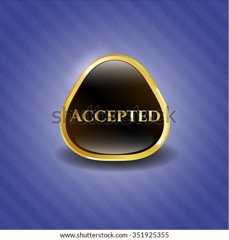 Accepted golden emblem or badge