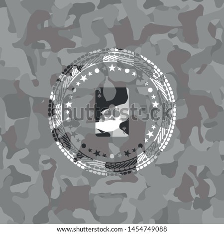 ace of clover icon on grey camo